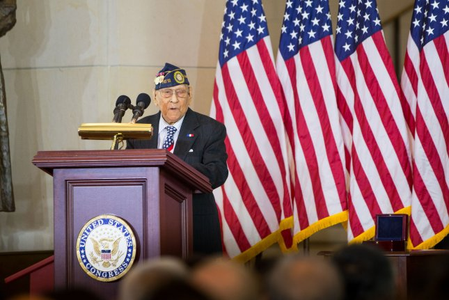 Celestino Almeda, a Filipino World War II veteran representing the Philippine Commonwealth Army, speaks during a ceremony with House and Senate leaders on Wednesday. Photo by Erin Schaff/UPI