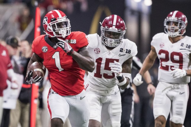 Georgia Bulldogs running back Sony Michel (1) looks back at Alabama Crimson Tide defensive back Ronnie Harrison (15) and Alabama Crimson Tide defensive back Minkah Fitzpatrick (29) on a long run in the first quarter of the NCAA College Football Playoff National Championship Game on January 8, 2018 at Mercedes-Benz Stadium in Atlanta. Photo by Mark Wallheiser/UPI