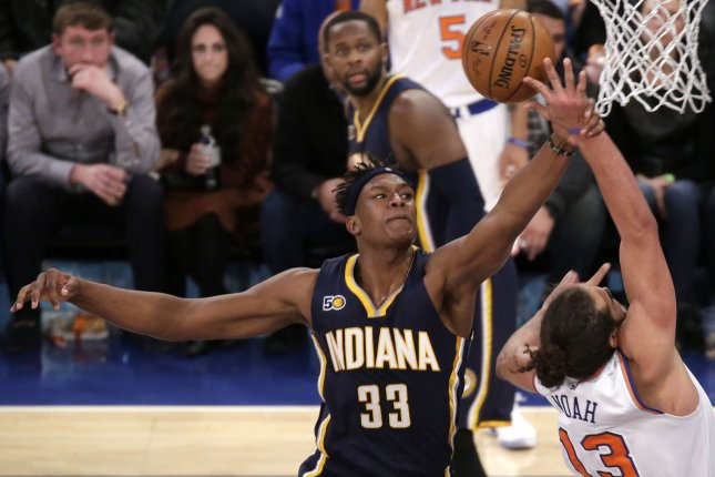 Indiana Pacers center Myles Turner hits the arm of New York Knicks' Joakim Noah as he takes a shot under the basket at Madison Square Garden in New York City. File photo by John Angelillo/UPI
