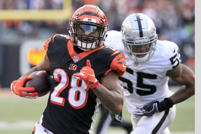 Cincinnati Bengals halfback Joe Mixon (28) runs in for the touchdown against the Oakland Raiders during the second half of play on Sunday at Paul Brown Stadium in Cincinnati, Ohio. Photo by John Sommers II/UPI
