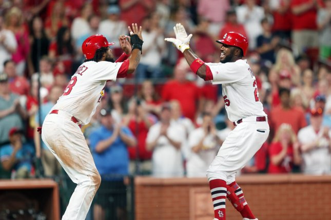 St. Louis Cardinals star Dexter Fowler (R) had four hits in a win against the Milwaukee Brewers on Monday in St. Louis. Photo by Bill Greenblatt/UPI