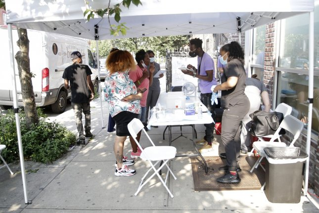 Patients are vaccinated on Thursday at a popup site in New York City launched by Amazon Studios and Carbon Health. Another popup site in Los Angeles will open next week and both will operate through the summer. Photo by John Angelillo/UPI
