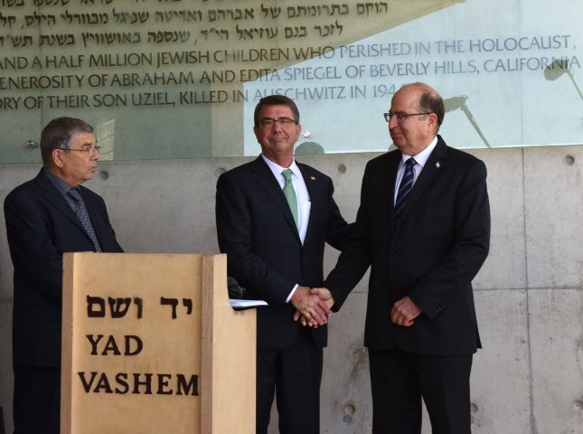 Israeli Defense Minister Moshe Ya'alon, right, shakes hands with U.S. Secretary of Defense Ashton Carter outside the Children's Memorial of the Yad Vashem Holocaust Museum that commemorates the 6 million Jews killed by the German Nazis during World War II, in Jerusalem, Israel, on Tuesday. Carter is visiting Israel to ease concerns over the nuclear deal with Iran. Photo by Debbie Hill/UPI