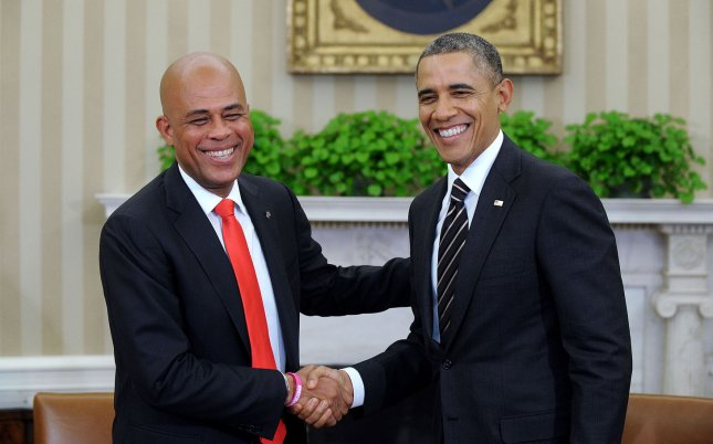 Presidential runoff elections in Haiti were called off on Friday amid reports of violent attacks on electoral offices, officials did not announce a new date for the elections. Current president Michel Martelly, seen here with Barack Obama, is constitutionally-mandated to leave the office on Feb. 7. File pool photo by Olivier Douliery/UPI