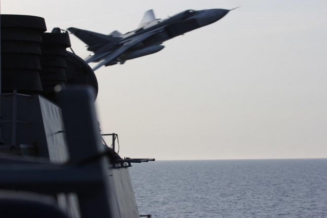 A Russian Sukhoi Su-24 attack aircraft makes a very-low altitude pass by the USS Donald Cook (DDG 75) on April 12, 2016, during maneuvers in international waters in the Baltic Sea. Donald Cook, an Arleigh Burke-class guided-missile destroyer, forward deployed to Rota, Spain, is conducting a routine patrol in the U.S. 6th Fleet area of operations in support of U.S. national security interests in Europe. Photo by U.S. Navy/UPI