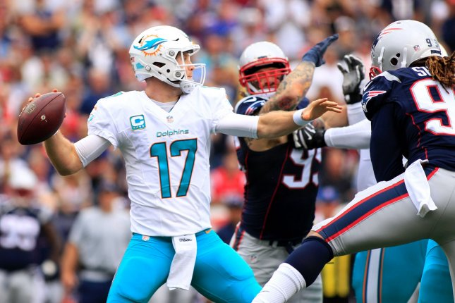 Miami Dolphins quarterback Ryan Tannehill (17) throws a pass in the first half against the New England Patriots at Gillette Stadium in Foxborough, Massachusetts on September 18, 2016. Photo by Matthew Healey/ UPI
