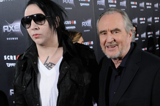 Musician Marilyn Manson (L) and director Wes Craven attend the premiere of the motion picture thriller Scream 4 in Los Angeles on April 11, 2011. Craven walked out of an early screening of Reservoir Dogs, that film's writer, director and co-star Quentin Tarantino said this weekend. File Photo by Jim Ruymen/UPI
