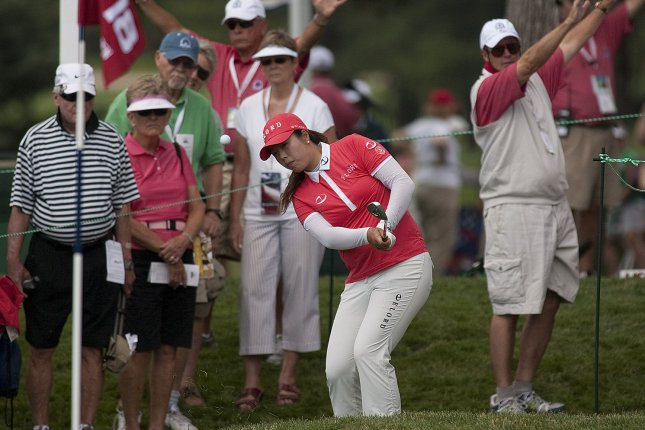 Shanshan Feng holds a one-stroke lead heading into the final round of the U.S. Women's Open. Photo by Gary C. Caskey/UPI