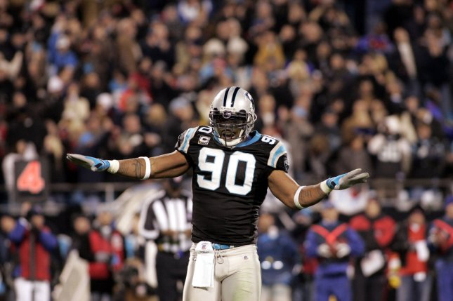 Carolina Panthers defensive end Julius Peppers (90) reacts after Tampa Bay missed a field goal attempt on December 8, 2008 at Bank of America Stadium in Charlotte, North Carolina. File photo by Nell Redmond/UPI