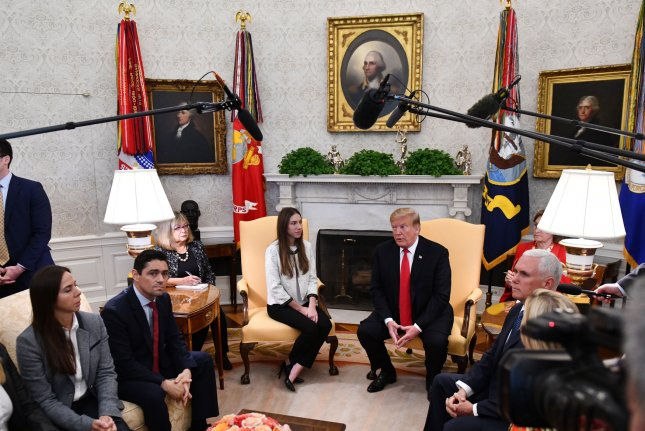 President Donald Trump meets with Fabiana Rosales, wife of Venezuelan opposition leader Juan Guaido, in the Oval Office of the White House in Washington, D.C., on March 27, 2019. Photo by Pat Benic/UPI