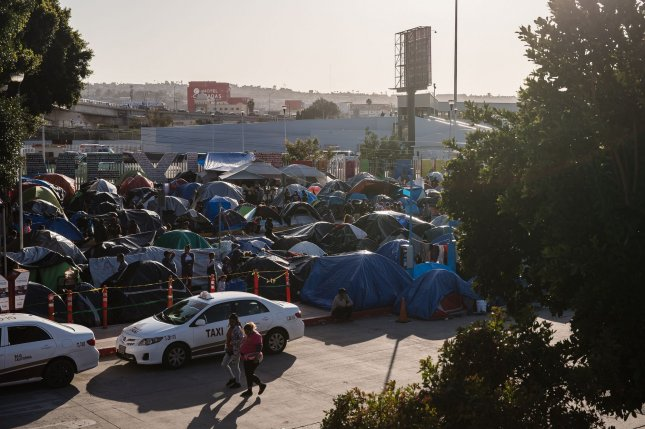 Hundreds of asylum seekers set up tents by the port of entry at El Chaparral plaza in Tijuana, Mexico, on March 26. Photo by Ariana Drehsler/UPI