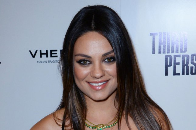 Cast member Mila Kunis attends the premiere of the motion picture romantic drama Third Person at the Pickford Center for Motion Picture Studio/Linwood Dunn Theatre in the Hollywood section of Los Angeles on June 9, 2014. Third Person tells the interlocking stories of love, passion, trust and betrayal involving three couples in three cities: Rome, Paris and New York. UPU/Jim Ruymen