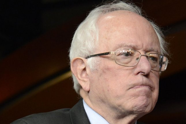 Sen. Bernie Sanders listens to remarks during a news conference Wednesday after Democrats met with President Barack Obama in the U.S. Capitol in Washington, D.C. On Monday, Sanders appeared at a town hall sponsored by CNN. Photo by Mike Theiler/UPI