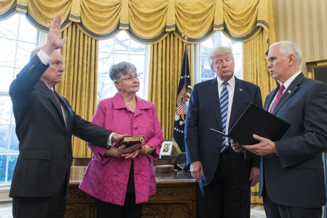 Jeff Sessions (L) is sworn in as attorney general by Vice President Mike Pence (R) as President Donald Trump and Mary Sessions watches, during a ceremony in the Oval Office at the White House on Thursday. Photo by Kevin Dietsch/UPI
