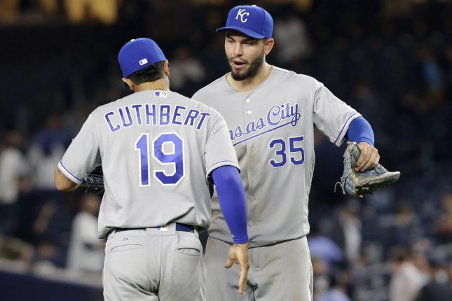 Kansas City Royals' Cheslor Cuthbert and Eric Hosmer celebrate after the game. File photo by John Angelillo/UPI