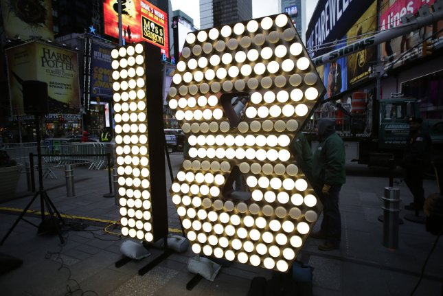 Workers surround the one and eight of the 2018 New Year's Eve numerals when they arrive in Times Square in New York City on December 13, 2017. Photo by John Angelillo/UPI