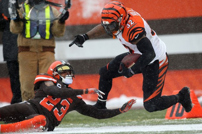 Former Cincinnati Bengals running back Jeremy Hill (32) is knocked out of bounds short of the goal line by ex-Cleveland Browns cornerback Joe Haden during the second quarter on December 11, 2016 at FirstEnergy Stadium in Cleveland. File photo by Aaron Josefczyk/UPI