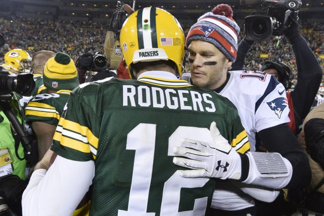 New England Patriots quarterback Tom Brady (R) hugs Green Bay Packers quarterback Aaron Rodgers after their game in 2014 at Lambeau Field in Green Bay, Wisc. File photo by Brian Kersey/UPI
