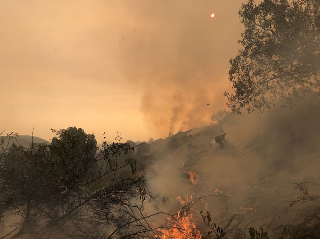 Research suggests that climate change, overaggressive wildfire suppression and a particularly hot and dry summer this year share the blame for increasing frequency, size and severity of wildfires in California. Photo courtesy Capt. Tim Gailey/Santa Barbara County Fire Department/UPI