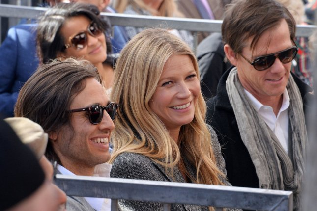 Gwyneth Paltrow (C), pictured with Brad Falchuk, gave an update on daughter Apple and son Moses on The Tonight Show starring Jimmy Fallon. File Photo by Jim Ruymen/UPI