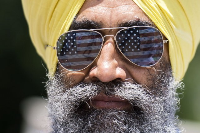 A Sikh protester wears American fag glasses as he demonstrates with others outside the White House prior to President Donald Trump's meeting with Indian Prime Narendra Modi in Washington D.C. on June 26, 2017. The group is calling for an independent Sikh state in India. Photo by Kevin Dietsch/UPI