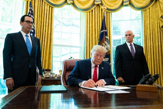U.S. President Donald Trump signs an executive order for additional sanctions against Iran in the Oval Office at the White House  on Monday.  Photo by Kevin Dietsch/UPI