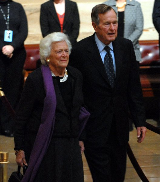 Former First Lady Barbara Bush and former President George H.W. Bush participate in the public viewing as former President Gerald R. Ford lies in state in the Rotunda of the U.S. Capitol in Washington on January 1, 2007. Ford passed away on December 26, 2006 at the age of 93. (UPI Photo/Roger L. Wollenberg)