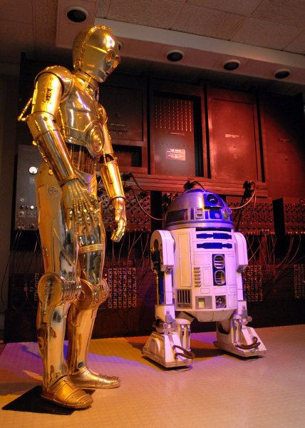 Star Wars robots C3PO and R2D2 are displayed at the Treasures of American History exhibit hosted by the Smithsonian's National Air and Space Museum in Washington on November 16, 2006. Artifacts from the American History Museum will be on display until the museum reopens after renovations. (UPI Photo/Roger L. Wollenberg)
