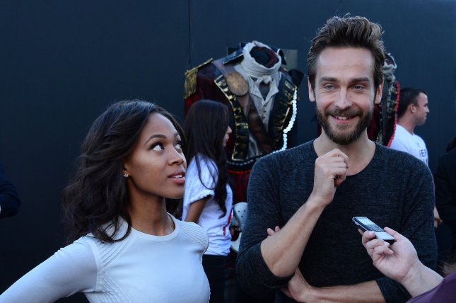Cast members Nicole Beharie and Tom Mison attend Fox's special screening of the television series Sleepy Hollow at the Hollywood Forever Cemetery in Los Angeles on June 2, 2014.