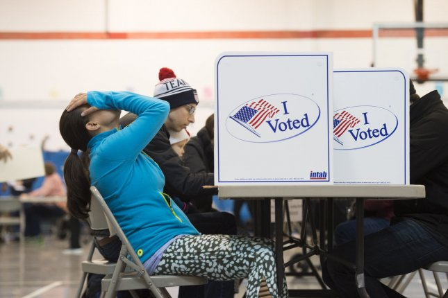 Voters fill out their ballots at Mt. Vernon Center in Alexandria, VA, November 8, 2016. Millions of Americans head to the polls Tuesday to choose the nation's 45th president, either Hillary Clinton or Donald Trump. Photo by Molly Riley/UPI