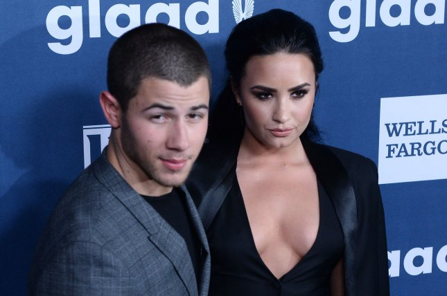 Demi Lovato (R) and Nick Jonas attend the GLAAD Media Awards on April 2, 2016. Lovato addressed reports Wednesday that her song Ruin the Friendship is about her feelings for Jonas. File Photo by Jim Ruymen/UPI