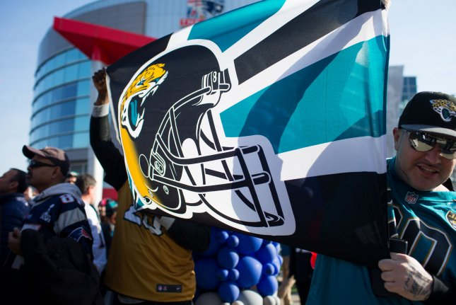 Jacksonville Jaguars fans hold up a team flag before the AFC Championship game against the New England Patriots at Gillette Stadium in Foxborough, Mass. on January 21, 2018. File Photo by Matthew Healey/ UPI