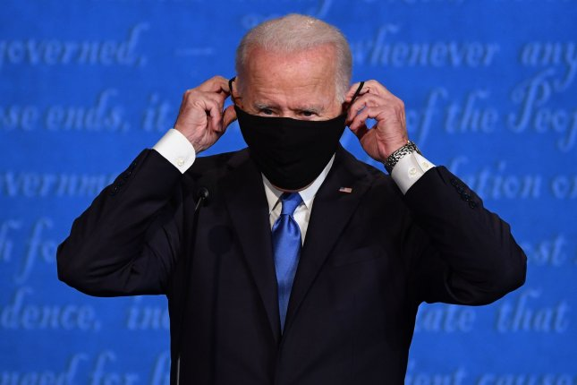 Democratic presidential candidate Joe Biden puts on a face mask after the final presidential debate October 22 at Belmont University, in Nashville. Biden said he won't shut down the economy but will fight to stop the COVID-19 virus. Photo by Kevin Dietsch/UPI