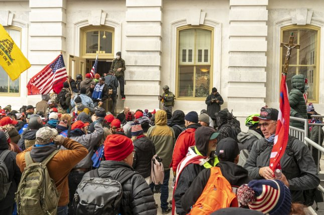 Rioters in support of former President Donald Trump breach the security perimeter and penetrate the U.S. Capitol to protest against the Electoral College vote count on January 6. Photo by Ken Cedeno/UPI