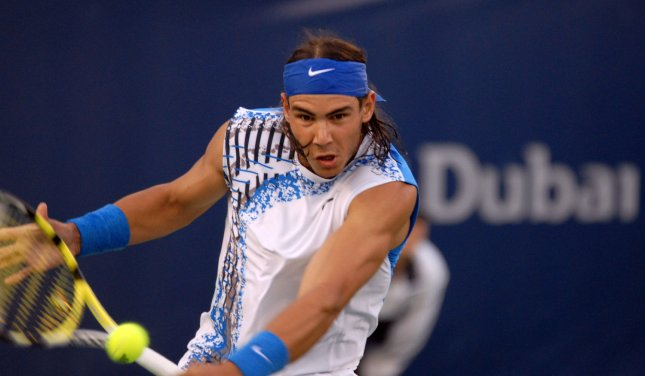 Spain's Rafael Nadal returns a ball from Russia's Mikhail Ledovskikh during the Dubai Tennis Championships on Wednesday March 5, 2008. Nadal won the match 6-4 6-0.(UPI Photo/Norbert Schiller)