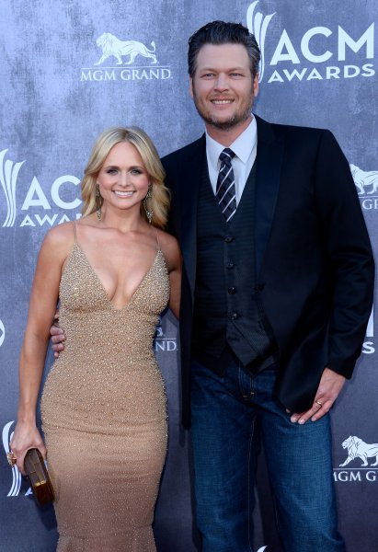 Miranda Lambert (L) and husband Blake Shelton are careful to protect their privacy. (UPI/Jim Ruymen)