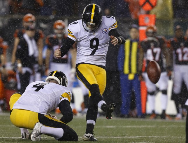 Pittsburgh Steelers kicker Chris Boswell (9) and holder Jordan Berry (4) kick a field goal against the Cincinnati Bengals during the first half of play in their NFL Wild Card Round game at Paul Brown Stadium in Cincinnati, Ohio, January 9, 2016. Photo by John Sommers II/UPI