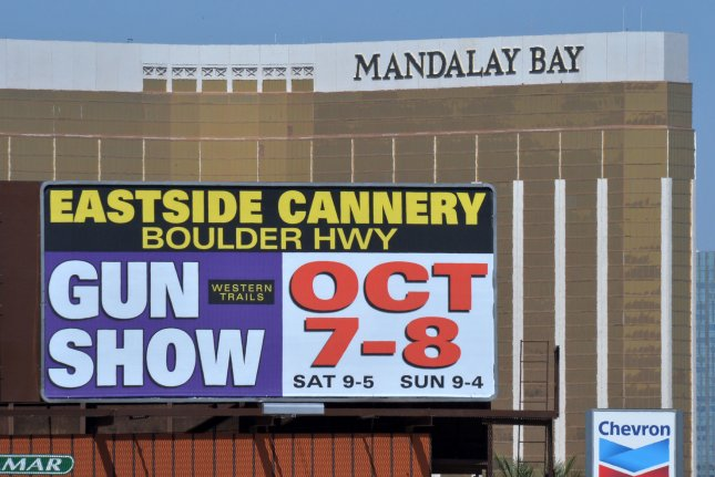 A billboard advertises a gun show near the Mandalay Bay Resort and Casino, where Stephen Paddock shot dozens of concertgoers during on October 4, 2017. File Photo by Jim Ruymen/UPI