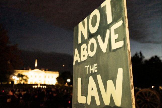 Protesters gather in front of the White House in support of special counsel Robert Mueller and his investigation of Russian meddling in the 2016 U.S. election. File Photo by Ken Cedeno/UPI