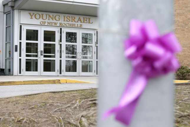 Purple ribbons hang outside of the Young Israel of New Rochelle synagogue in New Rochelle, N.Y., on Tuesday. Photo by John Angelillo/UPI