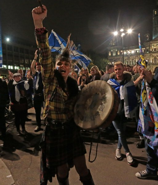 Yes campaigners carry flags on the day Scottish residents decide the future political direction their country will take in Glasgow, Scotland, on September 18, 2014. File Photo by Hugo Philpott/UPI