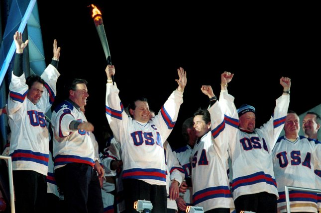 Captain Mike Eruzione of the 1980 U.S. Olympic hockey team celebrates with his teammates after lighting the Olympic cauldron during the opening ceremonies of the 2002 Olympic Winter Games in Salt Lake City on February 8, 2002. On February 22, 1980, in one of the most dramatic upsets in Olympics history, the underdog U.S. hockey team, made up of collegians and second-tier professional players, defeated the defending champion Soviet team, regarded as the world's finest, 4-3, at the Winter Games in Lake Placid, N.Y. File Photo by H. Ruckemann/UPI