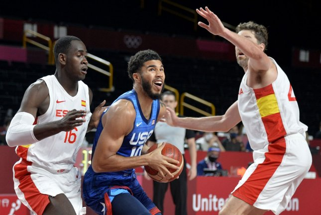 United States' Jayson Tatum (C) splits Spain's Usman Garuba (L) and Pau Gasol (R) during a men's basketball quarterfinal game at the Tokyo 2020 Olympics, Tuesday, in Tokyo, Japan. USA won 95-81 to advance to the semi-final round. Photo by Mike Theiler/UP