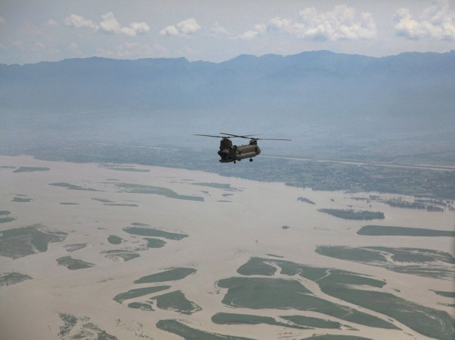 A U.S. Army Chinook helicopter flies over the flood affected area in Pakistan on a return flight from delivering humanitarian assistance and evacuating personnel to the town of Khwazakhela, as part of the flood recovery effort in Khyber Pakhtunkhwa province, Pakistan on August 11, 2010. UPI/Horace Murray/U.S. Army