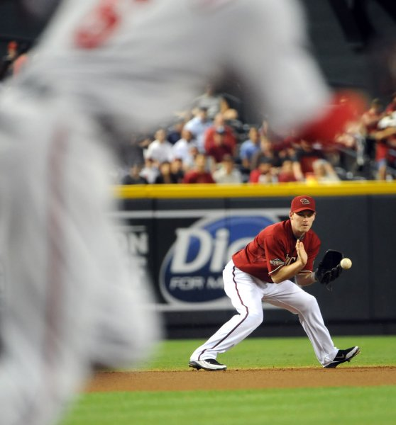 Shortstop Stephen Drew, then with the Arizona Diamondbacks, fields a ground ball at Chase Field in Phoenix, June 5, 2011. UPI/Art Foxall
