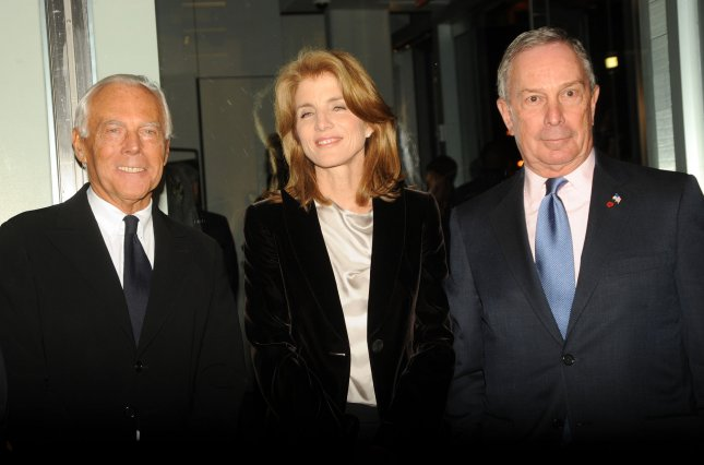 Designer Giorgio Armani (L) is joined by Caroline Kennedy and New York City Mayor Michael Bloomberg at the opening of an Armani/5th Avenue concept store in New York on February 17, 2009. (UPI Photo/Ezio Petersen)