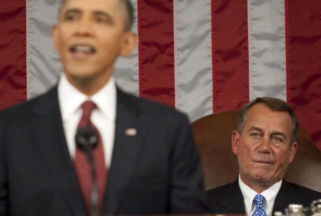 Speaker of the House John Boehner (R) listens as President Barack Obama delivers his State of the Union address in front of a joint session of Congress on January 24, 2012 at the US Capitol in Washington, DC. UPI/Saul Loeb/Pool