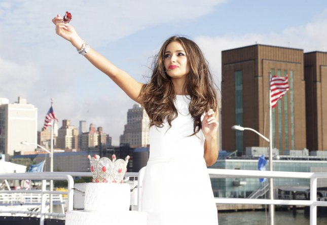 Miss Universe Olivia Culpo has a fork full of birthday cake aboard World Yacht celebrating her 21st birthday in New York City on May 8, 2013. Oliva Culpo was crowned Miss Universe this past December when she competed for the title as Miss USA. UPI/John Angelillo
