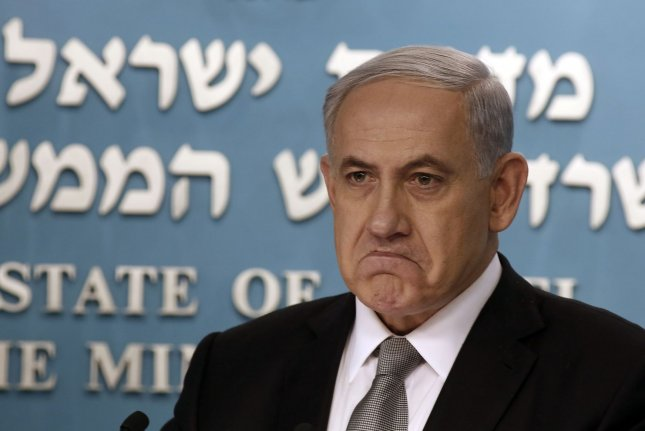 Israeli Prime Minister Benjamin Netanyahu speaks a press conference in Jerusalem on Dec. 2, 2014. He called for lawmakers to dissolve the country's Knesset, or parliament, which took place Monday. Photo by Gali Tibbon/UPI
