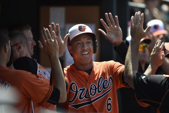 Baltimore Orioles' Jonathan Schoop (6) is congratulated in the dugout after scoring against the Tampa Bay Rays on a single by Francisco Pena during the sixth inning at Camden Yards in Baltimore, June 25, 2016. Photo by David Tulis/UPI